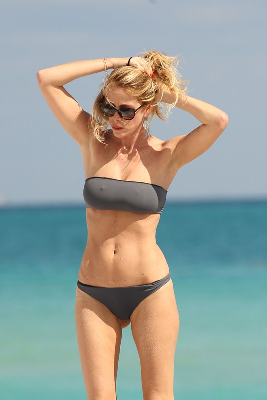 Italian actress Alessia Marcuzzi soaking up the sun in a grey bikini on Miami Beach