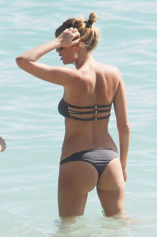 Italian TV presenter, model Alessia Marcuzzi shows off her assets  in a bikini in Miami Beach