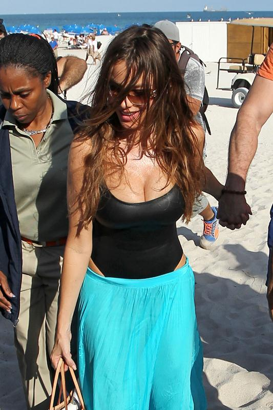 Sofia Vergara and fiance Nick Loeb walk back to their Miami hotel after an afternoon on the beach