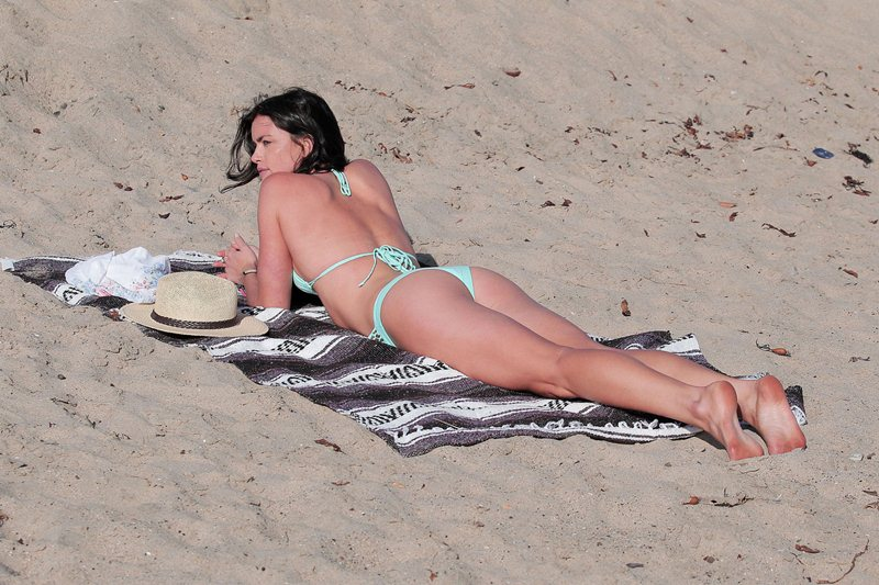 **EXCLUSIVE** Courtney Robertson shows what 'Bachelor' Ben Flajnik is missing as she frolics on the beach in a teal bikini