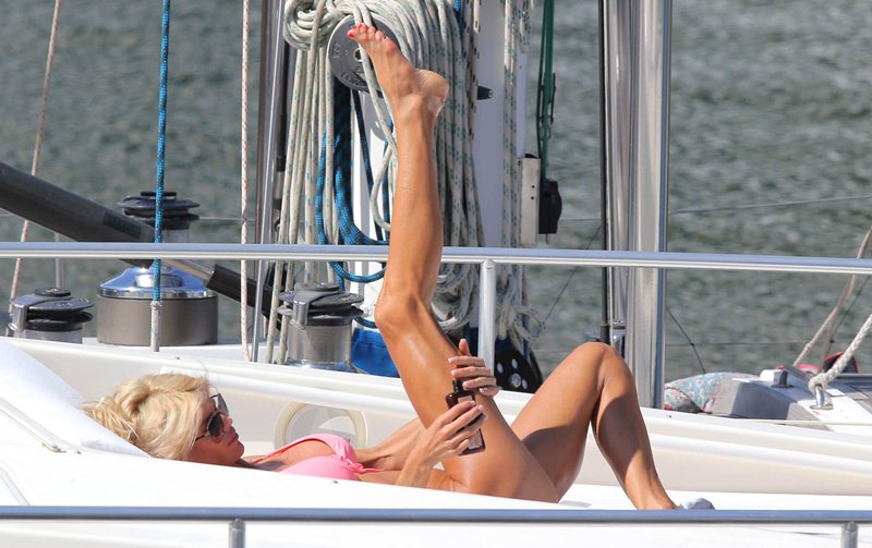 Victoria Silvstedt sunbathes on her yacht
