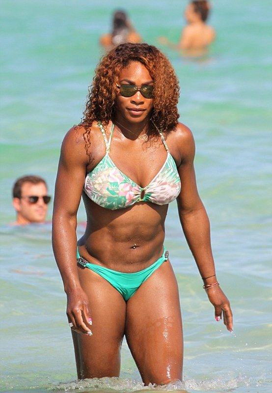 Serena Williams in a green floral print bikini at the beach in Miami
