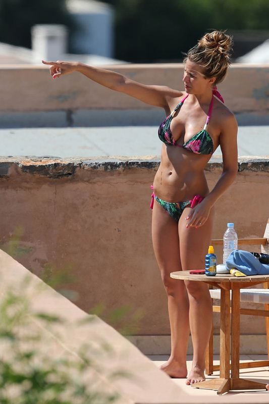 EXCLUSIVE: Gemma Atkinson is spotted relaxing in the sun with fiance, martial arts superstar Liam Richards.