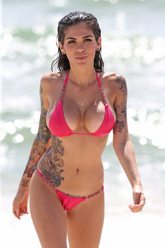 **EXCLUSIVE** Former TOWIE star Kirk Norcross's beautiful fiancee Cami Li relaxes on the beach with a friend in Miami