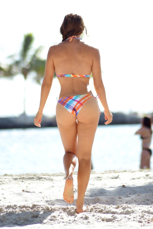 Popular sports model Andrea Calle puts on a show with a tiny bikini and some lotion