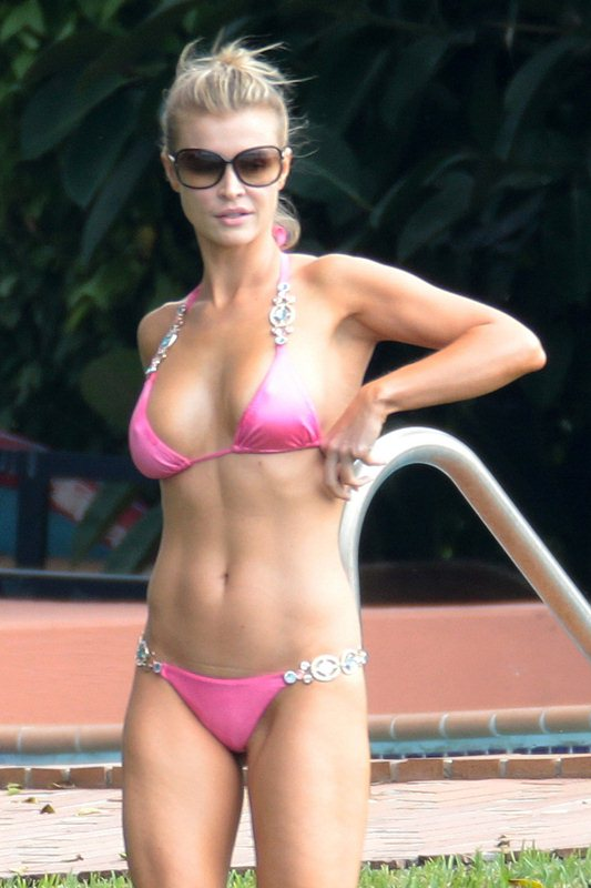 Joanna Krupa shows off her bikini body poolside in Miami