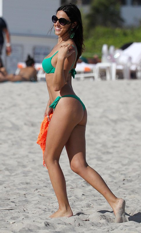 Italian actress Claudia Romani wearing a green bikini at a photoshoot at the W Hotel in Miami Beach