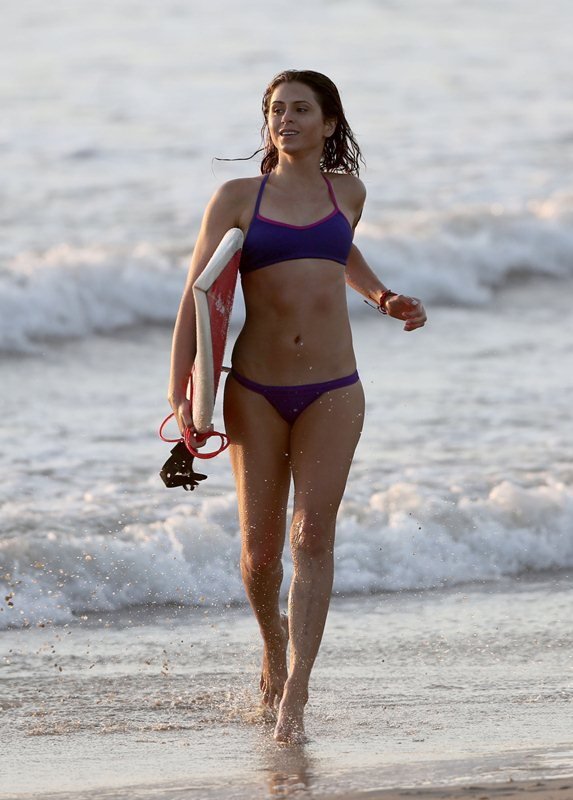 **EXCLUSIVE** SURF & TWERK QUEEN! Pro surfer Anastasia Ashley jumps into the chilly Pacific Ocean with nothing but a bikini for a new Budwieser commercial in Los Angeles