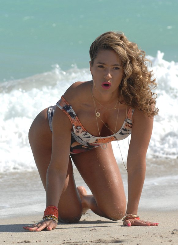 International fitness model Jennifer Nicole Lee hits the beach in a sexy one piece tiger swimsuit and shows off her inner tiger spirit at Miami Beach