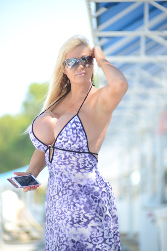 """EXCLUSIVE: Lacey Wildd, who was featured on """"My ge AddicAddiction"""" for her penchant for breast augmentation surgeries, seen stepping off a Yacht in Miami Beach"""