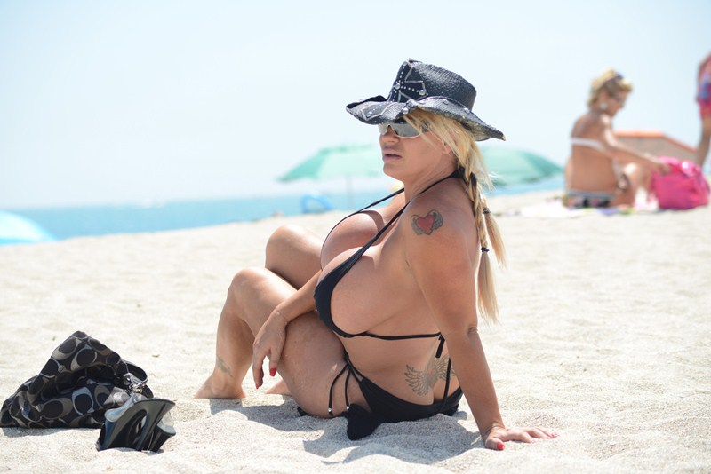 EXCLUSIVE: Reality TV Star Lacey Wildd flaunts her famous assets at Miami Beach