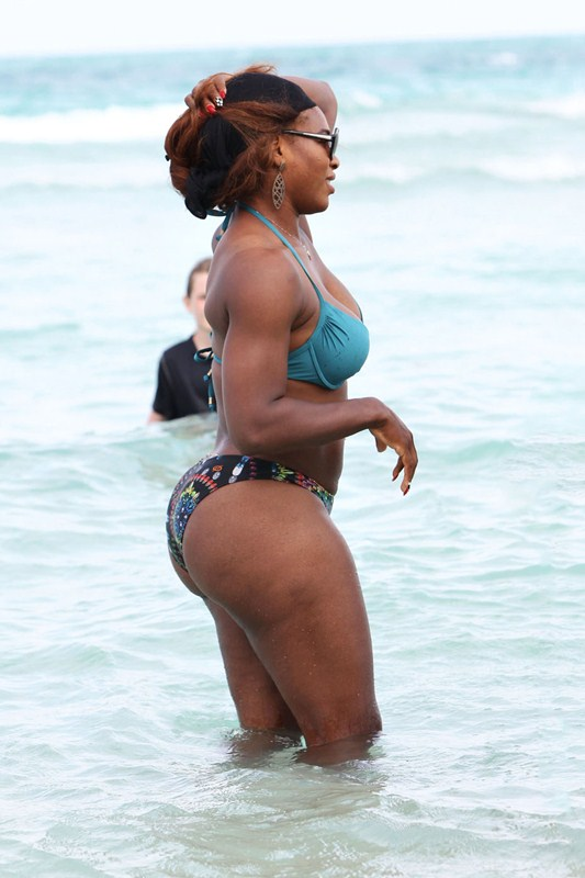 Serena Williams shows off her fit body as she takes a dip in the ocean with a friend on Miami Beach