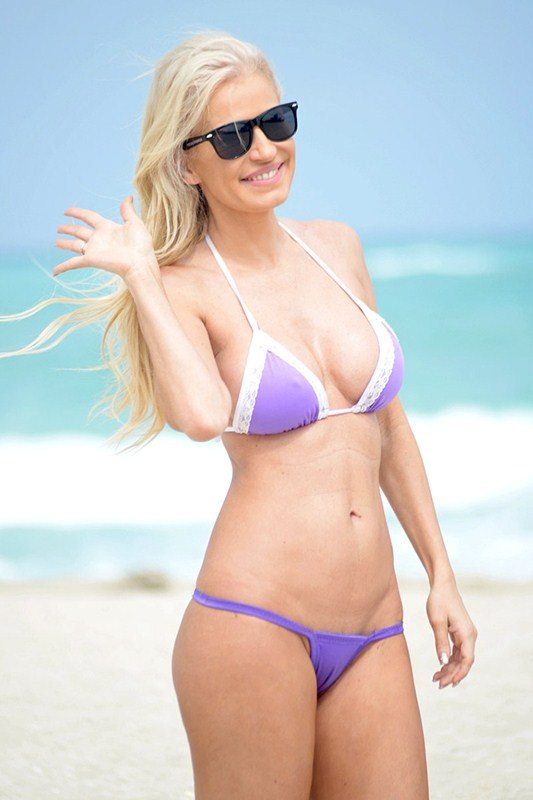 EXCLUSIVE: CONTAINS NUDITY - Model Ana Braga sunbathes on Miami Beach in a skimpy bikini