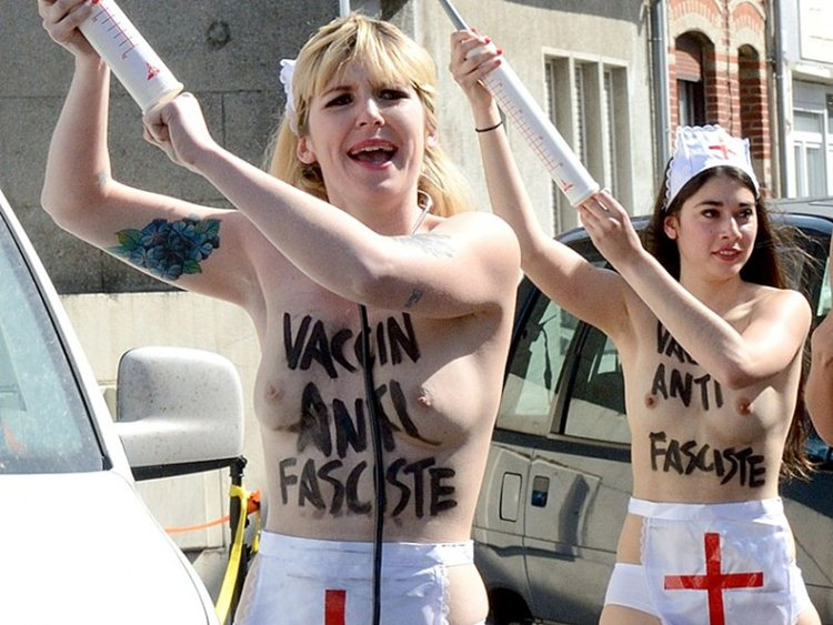 Topless-Members-Of-FEMEN-Protest-A-Front-National-Polling-Station-In-Henin-Beaumont-Kanoni-7