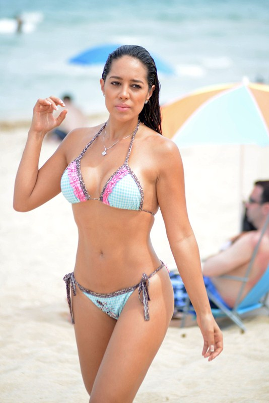 EXCLUSIVE: MMA broadcaster and model Andrea Calle seen taking a break from her hectic schedule by catching some sun on Miami Beach