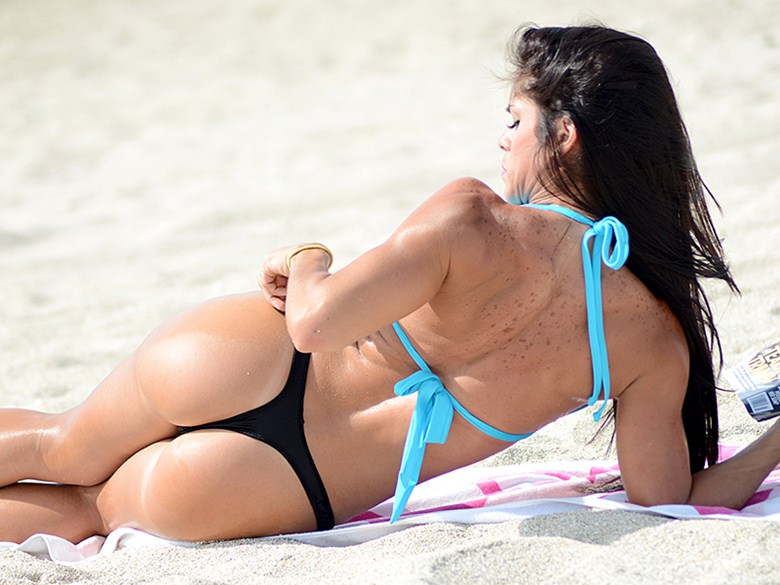 You lucky dog! Michelle Lewin gets puppy love on the beach