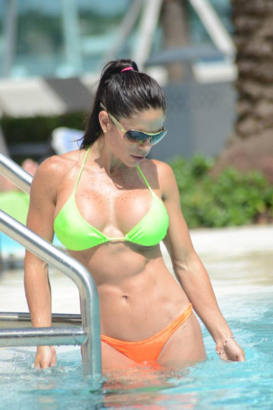 Michelle Lewin checks her bikini and listens to music by the pool