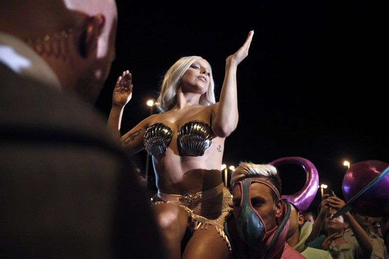Singer Lady Gaga performs for the crowd upon her arrival at the Athens' Eleftherios Venizelos airport