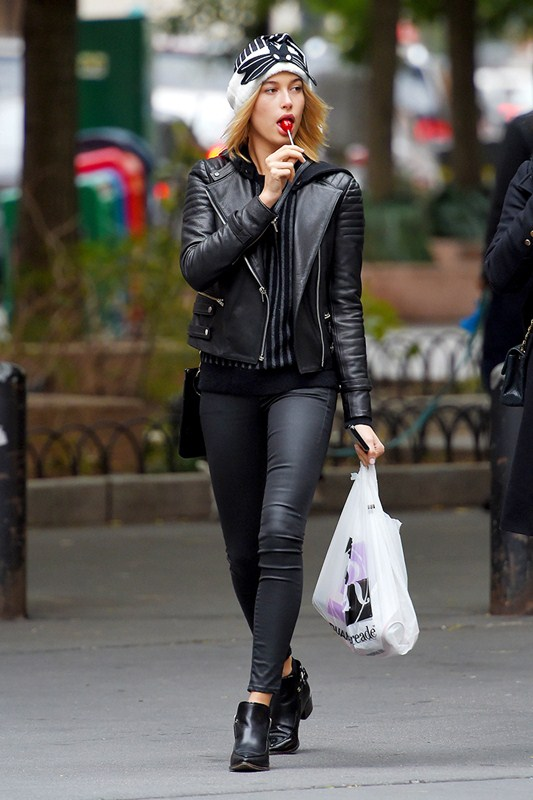 Hailey Baldwin walks out with a Lollipop in NYC
