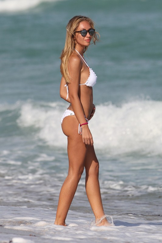 Italian model Laura Cremaschi  wears a white bikini to the beach in Miami