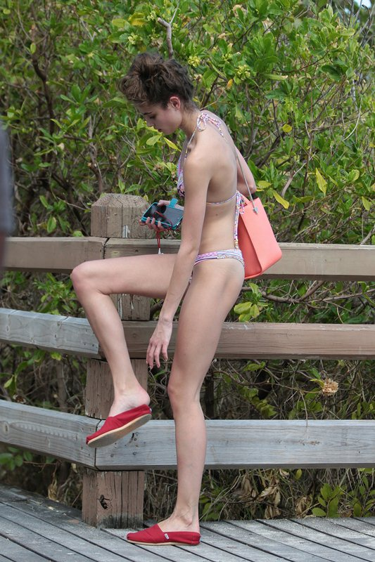 EXCLUSIVE: New Victoria's Secret model Taylor Hill shows off her long limbs in a pink bikini while out for a walk in Miami