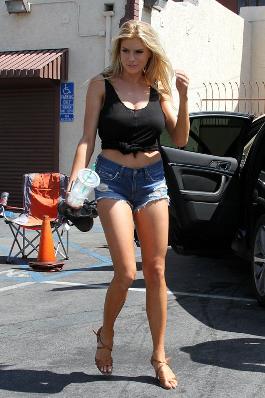 Sultry bombshell Charlotte McKinney vamps it up for the cameras