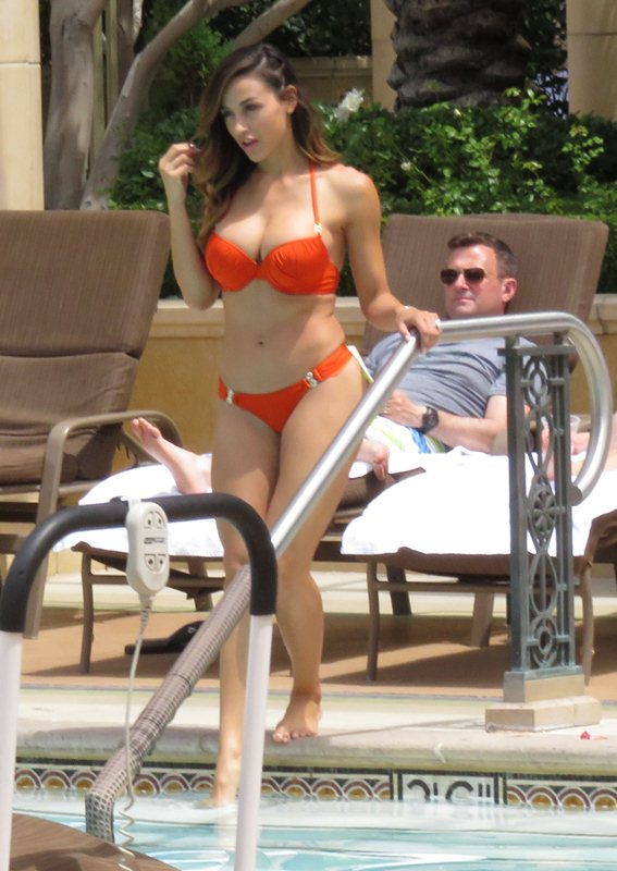 Playboy playmate Ana Cheri has two guy watch her take a dip in the pool in Las Vegas