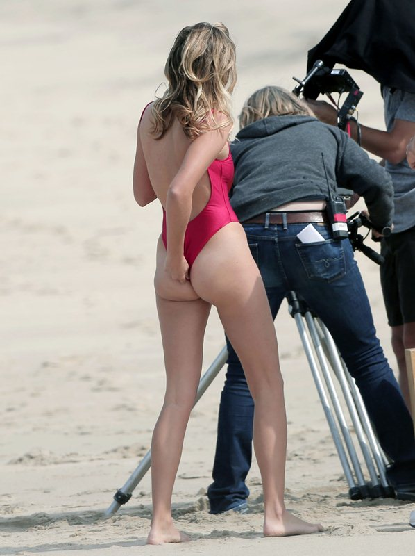 EXCLUSIVE: British model Keeley Hazell is spotted on an LA beach in a high-rising Baywatch style bathing suit doing a spot for National Geographic