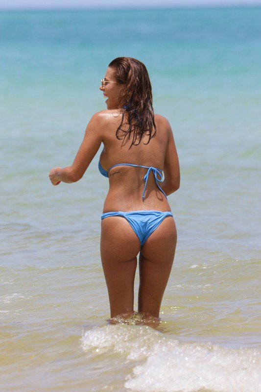 Devin Brugman in a blue bikini at the beach in Miami Beach, FL