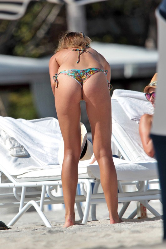 Polish model Sandra Kubicka shows off her toned body in a brightly colored Luli Fama bikini at the beach in Miami