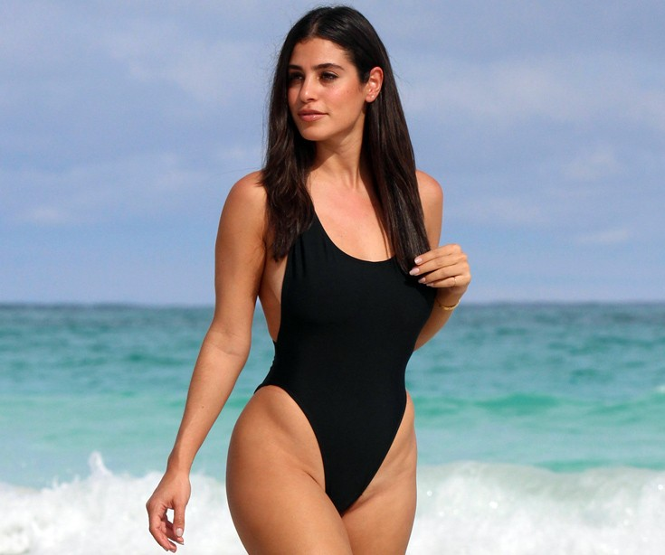 Nicole-Isaacs-travel-blogger-black-swimsuit-bahamas-beach-kanoni-7