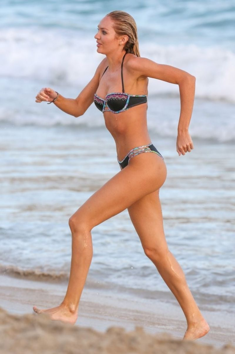 candice-swanepoel-on-the-set-of-vs-photoshoot-at-the-beach-in-st.-barts-kanoni-10