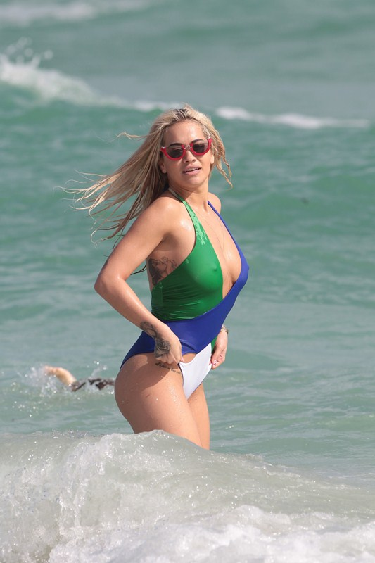 Rita Ora and Daisy Lowe show off their bikini bodies on the beach in Miami