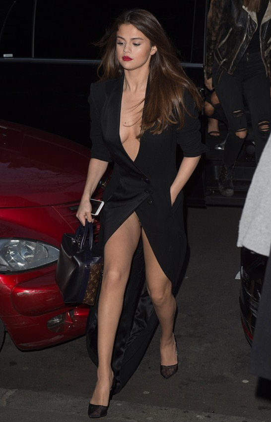 Selena Gomez leaves her Paris hotel. Her knickers were showing as she walked from her car.
