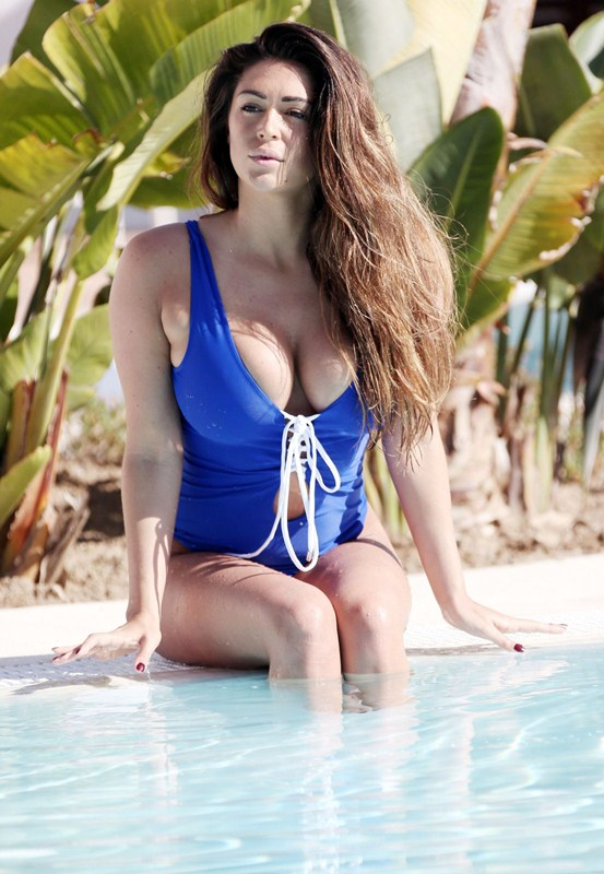casey-batchelor-in-blue-swimsuit-at-a-pool-in-marbella-kanoni-10