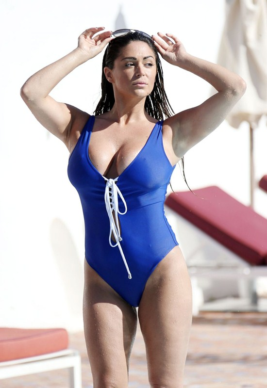 casey-batchelor-in-blue-swimsuit-at-a-pool-in-marbella-kanoni-2
