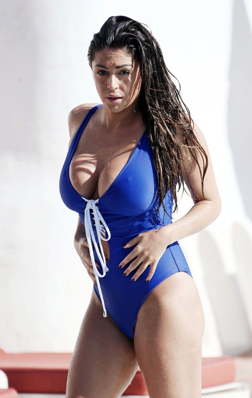 casey-batchelor-in-blue-swimsuit-at-a-pool-in-marbella-kanoni-4