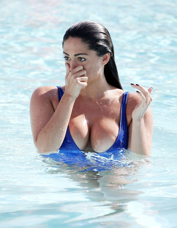 casey-batchelor-in-blue-swimsuit-at-a-pool-in-marbella-kanoni-6