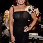 Η Kimberly Guilfoyle χωρίς σουτιέν με see through μαύρο φόρεμα στο Zang Toi Fashion Show